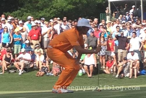 Rickie Fowler sizing up his par putt on 16